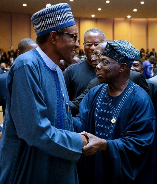 See President Buhari Reaction As He Meets OBJ In AU Summit (See Photo)